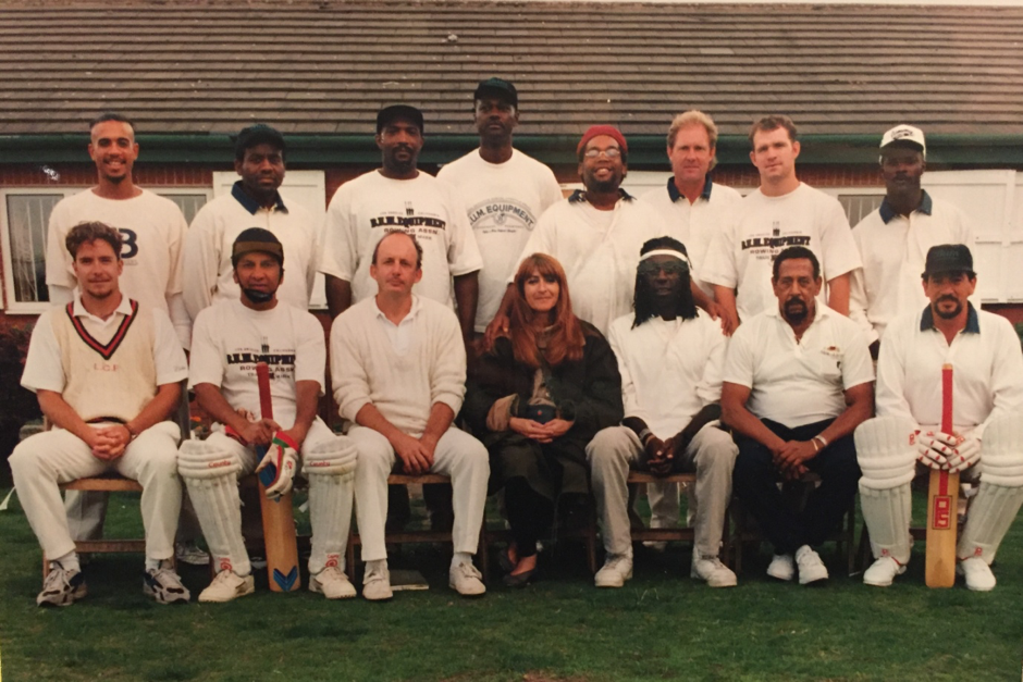 LA Krickets team photo prior to first game of the tour at Blackrod CC, Bolton, Lancashire. September, 1995. (Mustafa Khan is 4th from left, back row. Front row from left: Stephen Speak, Mark Azeez, David Sentance, Katy Haber, Ted Hayes)
