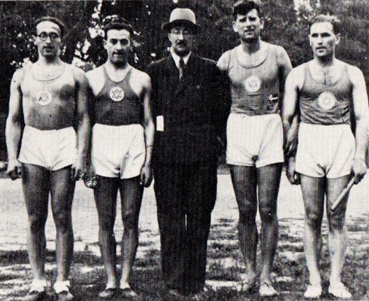 The winning relay 4 x 400 in 1937 Austrian championship left to right - Präger, Kaiser, coach Bierbrauer, Deutscher, König