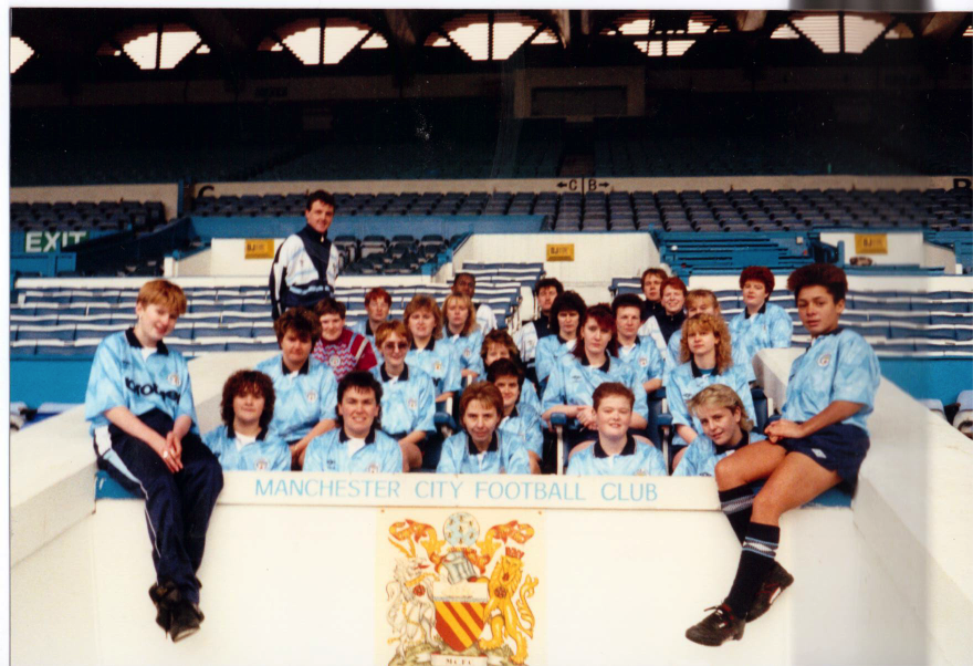 The Manchester City Ladies squad in 1989 sat in the Directors' Box at Maine Road